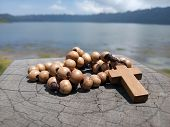 Wooden Rosary On Wood  With Jesus Christ Cross Crucifix. Christian Catholic Religious Symbol Of Fait poster
