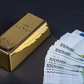 Euro Cash And Gold Bar On A Black Background. Banknotes. Money. Bill. Ingot. Bullion. poster