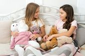Soulmates Concept. Sisters Sharing Toys. Sisters Best Friends. Kids Play Toys In Bed. Little Girls S poster