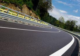 pic of twisty  - Asphalt twisty mountain road in hills in Slovakia - JPG