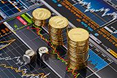 stock photo of dice  - Dices cubes with the words SELL BUY downtrend stacks of golden coins - JPG