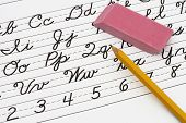 stock photo of cursive  - Example of cursive writing with a pencil and easer Learning cursive writing - JPG