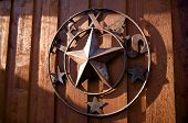 image of texas star  - An image of a rustic Texas star hanging - JPG