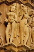image of kandariya mahadeva temple  - Sculptures ofreligious figures decorating the ancient Kandariya Mahadeva Hindu Temple at Khajuraho Uttar Pradesh India. 11th Century AD. ** Note: Slight blurriness, best at smaller sizes - JPG