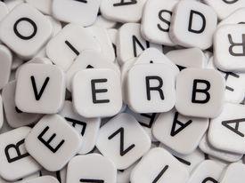 foto of verbs  - Verb letters spelled on white letter tiles - JPG