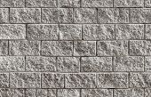 stock photo of stonewalled  - Seamless background photo texture of gray rough brick wall - JPG