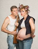 foto of hillbilly  - Concerned pregnant hillbilly couple with rifle gun - JPG