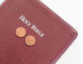 foto of tithe  - Holy Bible with money on top - JPG