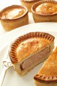 traditional pork pies on white background