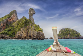 pic of nic  - Railay beach in Krabi Thailand with blue sea and boat - JPG