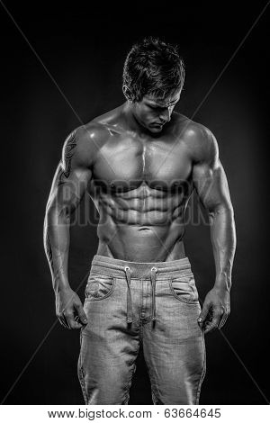 Strong Athletic Man Fitness Model Torso Showing Six Pack Abs. picture