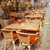 European Street view of a coffee terrace with tables and chairs