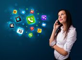 Attractive young woman calling by phone with various icons