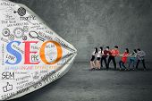 stock photo of korean  - Portrait of business people pulling SEO banner - JPG