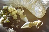 foto of ceremonial clothing  - Wedding shoes with bouquet of white roses  on chair - JPG