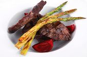 grilled red beef pork meat barbecue steak fillet with asparagus and hot pepper served on deep plate