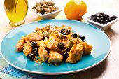 stock photo of swordfish  - a dish with swordfish stew with caper and olives - JPG