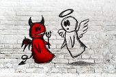 picture of angel devil  - Doodle drawing of angel and devil fighting on white brick wall - JPG