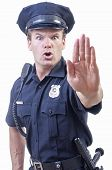 foto of officer  - Male Caucasian police officer in blue cop uniform holds up hand in stop gesture on white background - JPG