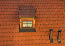 foto of gabled dormer window  - Photo of an Attic Dormer on a Red Tile Roof with Chimney Stacks - JPG