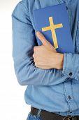 stock photo of bible verses  - Man holding Bible close up - JPG