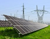 pic of electricity pylon  - Solar energy panels with electricity pylons  - JPG