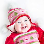 image of christmas baby  - Happy laughing baby girl in a red dress with Christmas hat - JPG