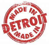 picture of manufacturing  - Made in Detroit words in a red round grunge stamp as a badge or logo for products manufactured in the Motor City in Michigan - JPG