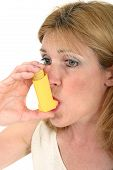 pic of asthma inhaler  - Woman demonstrates the use of an asthma or bronchial inhaler - JPG