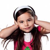 pic of young girls  - Young girl being stubborn and covering her ears - JPG