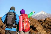 image of canary  - Hikers looking at view pointing hiking in mountain - JPG