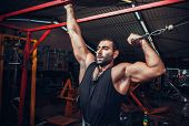 stock photo of muscle builder  - Body Builder Working Out At Gym - JPG