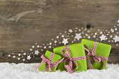 stock photo of certificate  - Green christmas presents on wooden background for a gift certificate - JPG