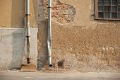 foto of stone house  - Two drainpipe on a very old stone house - JPG