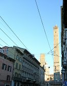 picture of tram  - ancient tower called DEGLI ASINELLI in Bologna Center in Italy with tram wires - JPG