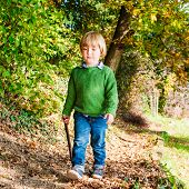 stock photo of pullovers  - Outdoor portrait of a cute little boy wearing green pullover - JPG