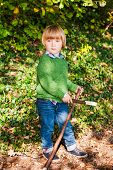 image of pullovers  - Outdoor portrait of a cute little boy wearing green pullover - JPG