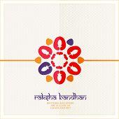 stock photo of rakhi  - Colorful heart decorated Rakhi on beige background for the festival of Raksha Bandhan celebrations - JPG