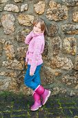 picture of pullovers  - Outdoor portrait of adorable little girl wearing pink pullover - JPG