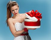 picture of gift wrapped  - Thoughtful girl holding holiday or birthday presents - JPG