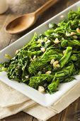 stock photo of sauteed  - Homemade Sauteed Green Broccoli Rabe with Garlic and Nuts - JPG