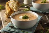 stock photo of lobster tail  - Homemade Lobster Bisque Soup with Cream and Parsley - JPG