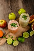 picture of smoothies  - Fresh organic smoothie lime with banana and grepfruit with green and red apple - JPG