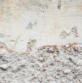 stock photo of fragmentation  - Old grungy concrete wall fragment as an abstract background composition - JPG