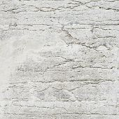 foto of fragmentation  - Old grungy concrete wall fragment as an abstract background composition - JPG