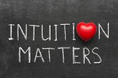 picture of intuition  - intuition matters phrase handwritten on blackboard with heart symbol instead of O - JPG
