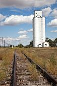 picture of silo  - Old train tracks and grain silo in Colorado - JPG
