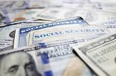 picture of social-security  - Two Social Security cards and assorted cash - JPG