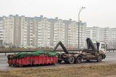 picture of truck-stop  - Truck with waste container and flat tire stopped on the load - JPG