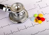 stock photo of diabetes mellitus  - Electrocardiogram graph report with stethoscope on it - JPG